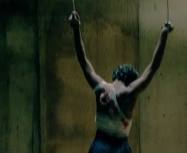 Omar wounded hanging from his wrists