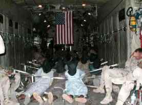 C-130 Prisoner Transport to Guantanamo Bay, Cuba--Images leaked to international news agencies in 2002 by anonymous source.